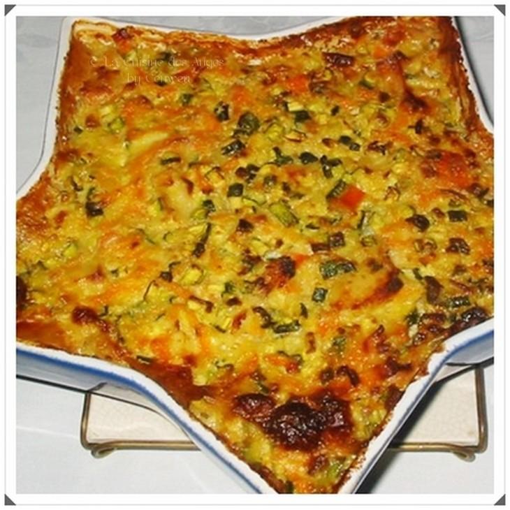 Recette de poisson blanc et de surimi cuisinés en gratin avec des petits légumes et une sauce au vin blanc à la crème